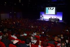 A picture of the packed auditorium in Telford